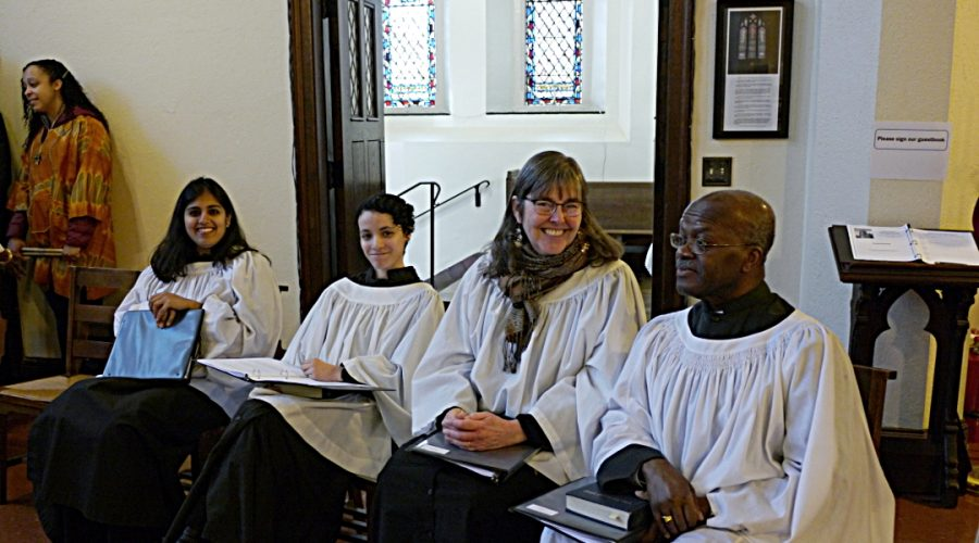 Photo of Saint Peter's choir chatting before Sunday service begins