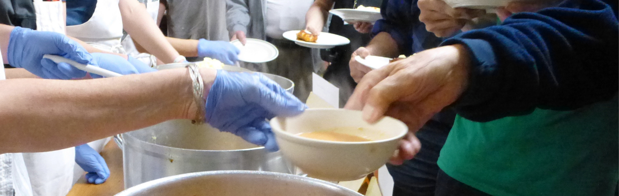 Photograph of serving soup at a CommonCare meal at Saint Peter's Episcopal Church