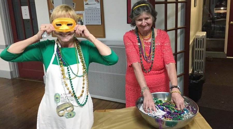 Photograph of Saint Peter's members having fun at a Mardi Gras party