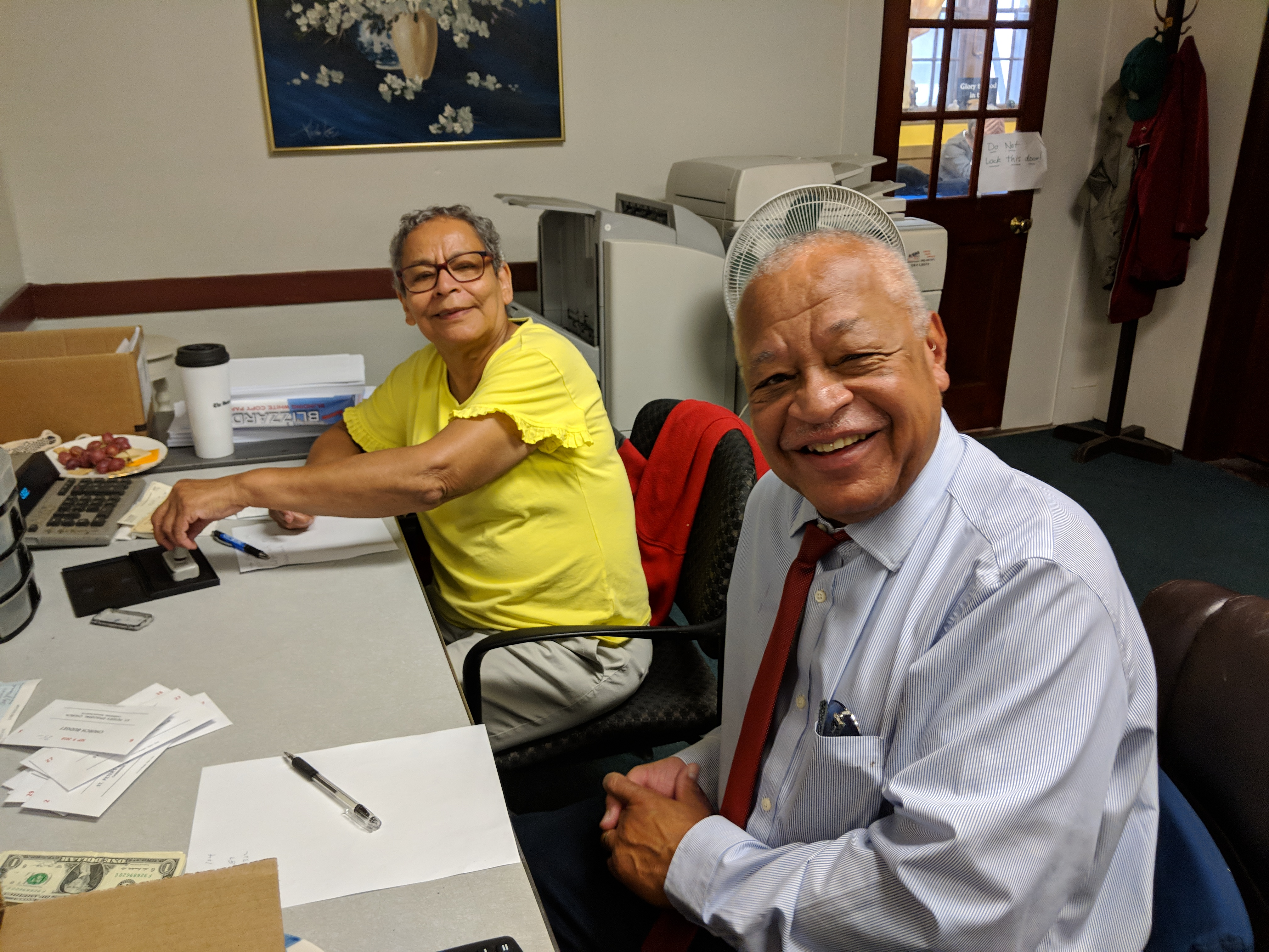 Our collectors counting a Sunday Collection in the church office
